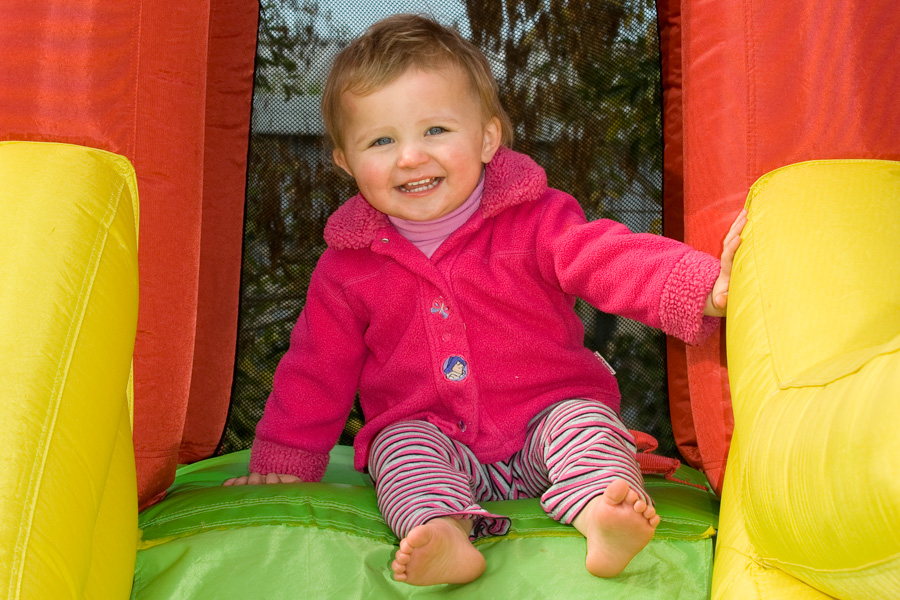 Photo of toddler playing on a jumping castle